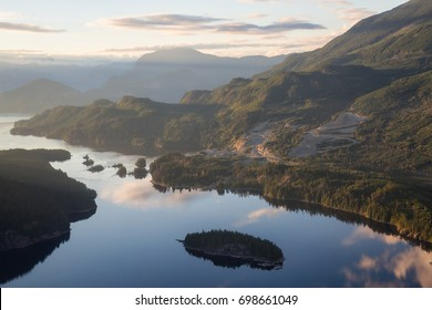 Aerial view of Skookumchuck Narrows and a Mining Industrial site. Picture taken from an airplane in Sunshine Coast, Northwest of Vancouver, British Columbia, Canada, during a sunny summer sunset.
