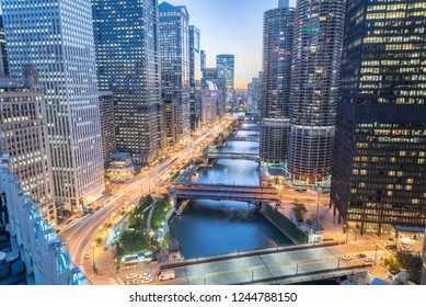 Aerial view of skyline along Chicago river through downtown at sunset