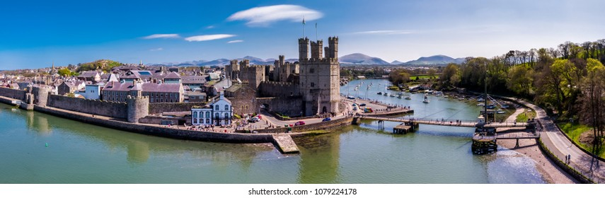 Aerial view of the skyline of Caernafon with the historic castle, Gwynedd in Wales - United Kingdom.