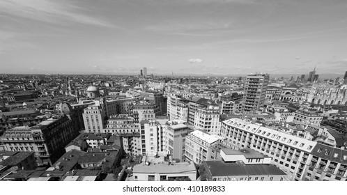 Aerial view of the skyline of the city of Milan, Italy in black and white