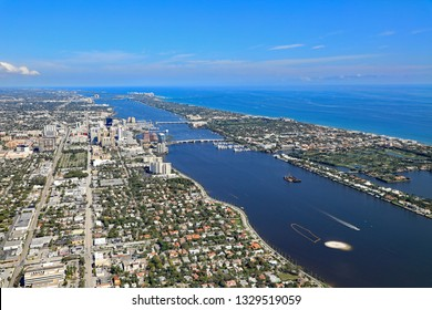 Aerial view of the skyline of West Palm Beach, and Palm Beach, Florida, and the Lake Worth Lagoon, with new artificial islands being made.