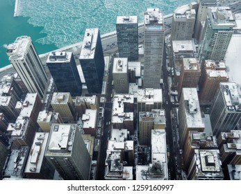 Aerial view of skyscrapers and city of Chicago, Illinois, USA. Winter urban landscape, during a snowstorm in Christmas.