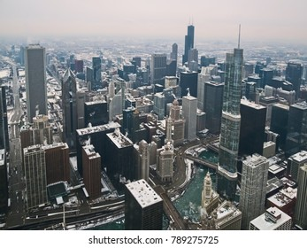 Aerial view of skyscrapers and city of Chicago, Illinois, USA. Winter urban landscape, during a snowstorm in Christmas of 2017.