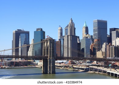 Aerial view of Skyscrapers in Financial District of Lower Manhattan through Brooklyn Bridge, New York City, USA.