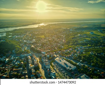 Aerial view of Slatina city at sunset, Romania. Drone flight over the european city at sunset.