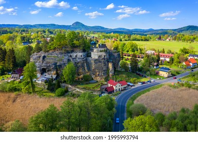 Aerial view of Sloup Castle in Northern Bohemia, Czechia. Sloup rock castle in the small town of Sloup v Cechach, in the Liberec Region, north Bohemia, Czech Republic.  - Shutterstock ID 1995993794