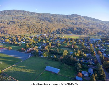 Aerial view of small Canadian village set against mountains