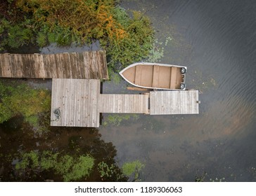 Aerial view of a small dock with a rowboat