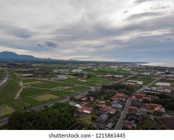 Aerial view of small Japanese farming town on the coast