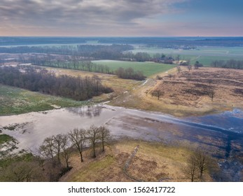 Aerial view of small scale landscape in Friesland Netherlands with windbreak shelter trees and pools
