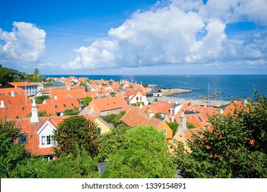 Aerial view of small town  with beautiful, tiny houses at the seaside, Gudhjem, Bornholm, Denmark