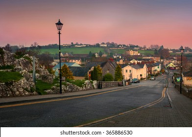 Aerial view of small town Cashel in Tipperary County of Ireland, Colorful sunset sky