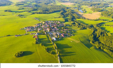 Aerial view of a small town in countryside. Scenic seasonal landscape from above. Slavce in South Bohemia, Czech republic, European union.
