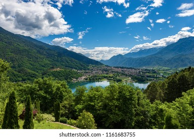 Aerial view of the small town of Levico Terme with the lake (Lago di Levico) and the mountains, Alps. Trentino Alto Adige, Italy, Europe