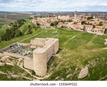 Aerial view of the small town of Medinaceli in Soria, Spain, with the ruins of the castle in the foreground and the Colegiata in the background.