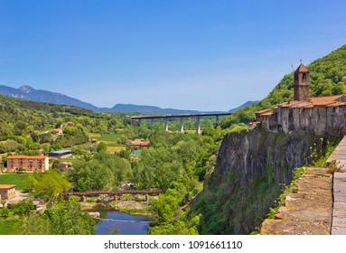 Aerial view of small village Castellfollit de la Roca, Spain with old church on the rock