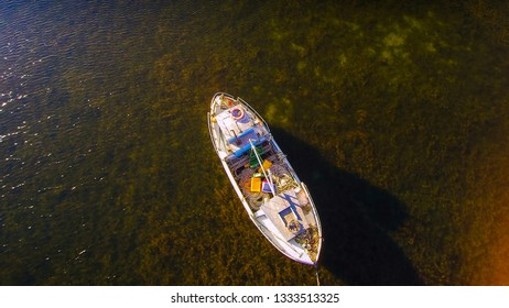Aerial view of the small white boat in the middle of the sea in Sorve Saaremaa