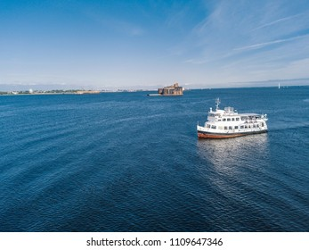 Aerial view of a small white passenger ship going along the Finnish Gulf