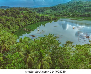 Aerial View of the Smallest Lake in San Pablo City, Laguna, Philippines - Lake Mohicap - in a cloudy afternoon