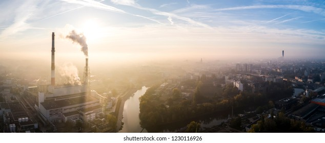 Aerial view of the smog over the city in the morning, smoking chimneys of the CHP plant and the city's buildings - Wroclaw, Poland