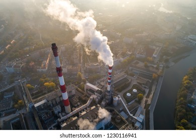 Aerial view of the smog over city, smoking chimneys of the CHP plant and the city's buildings - Wroclaw, Poland