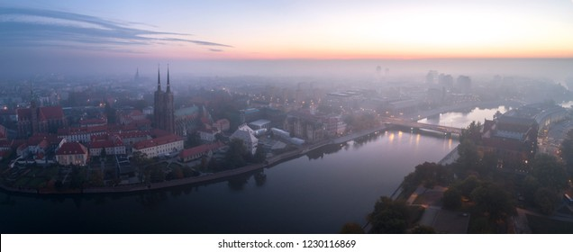 Aerial view of the smog over the waking city at dawn, in the distance buildings covered with fog and smog - Wroclaw, Poland