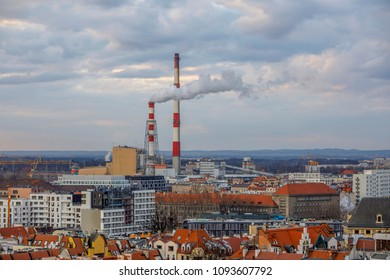 Aerial view of the smoking chimneys of the CHP plant and the city's buildings - Wroclaw, Poland