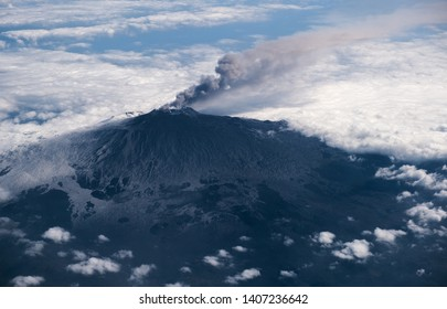 Aerial view of smoking Mount Etna volcano on Sicily.