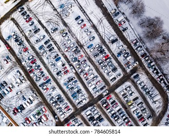 Aerial view of snow compromised carpark in England. Snow, ice and winter weather conditions strand motorists in a frozen, snowed-in carpark
