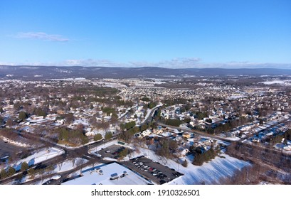 Aerial view of snow covered Frederick Maryland looking north on opossumtown pike