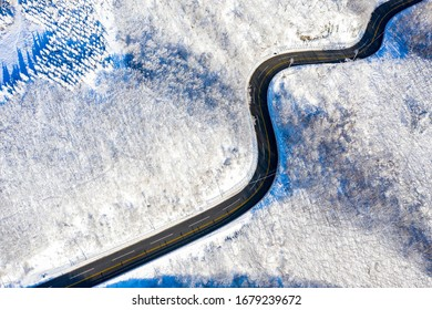 Aerial view of snow covered mountain and curved road at Daegwallyeong near Pyeongchang-gun, Korea
