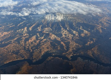 Aerial view of snow covered mountains and river