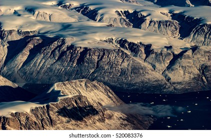 aerial view, snow covered mountains, greenland