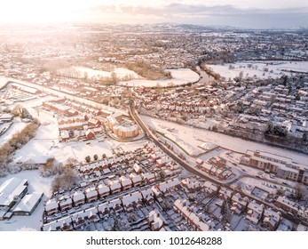 Aerial view of snow covered traditional housing suburbs in England. Snow, ice and adverse weather conditions bring things to a stand still in the housing estates of a British suburb