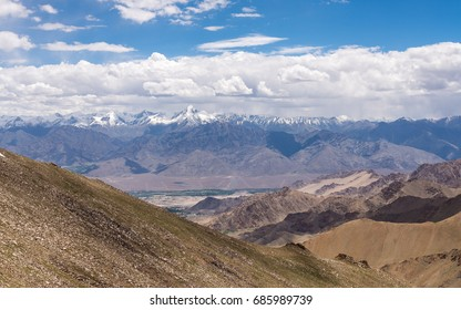 Aerial view of snow peaks, Leh ladakh landscape, cloud formation , Jammu and Kashmir, India