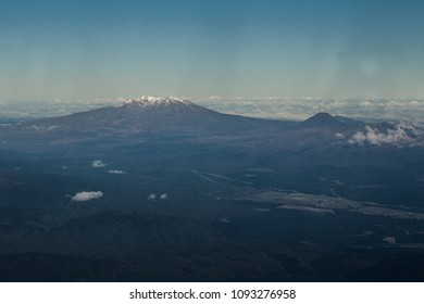 An aerial view of snow-capped Mount Ruapehu, and nearby Mount Ngauruhoe, active volcanoes in the Taupo Volcanic Zone in Tongariro National Park, in the North Island of New Zealand