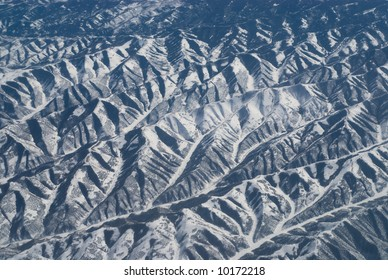 Aerial view of snow-covered mountain ranges