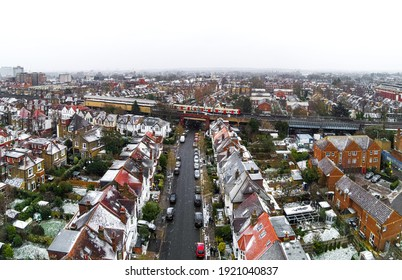 Aerial view of snowy London suburb in winter, UK