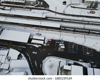 Aerial View of snowy Train Station Railways  - Shutterstock ID 1885239169