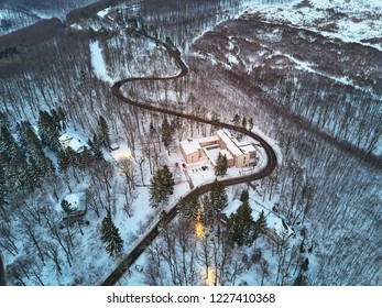 Aerial view snowy winter road in the mountains