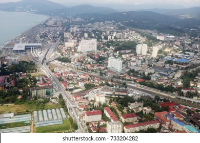 Aerial view of Sochi - city among mountain and near sea in Russia