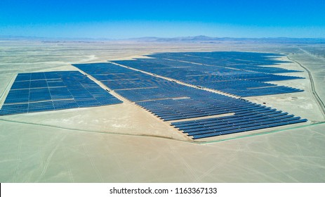 An aerial view of a Solar Energy PV Plant over the Atacama desert in Chile, trying to get the energy from the sun with Solar Energy