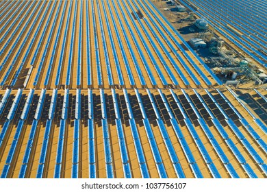 Aerial view of a solar farm producing clean renewable photovoltaic energy in California, industrial landscape