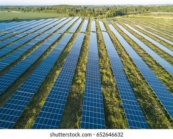 An aerial view of a solar farm set in the english countryside