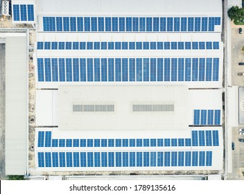 Aerial view of solar panel on roof of building to show conversion energy from sunlight into electricity then storage by charging in battery. For alternative or clean energy concept or background etc.