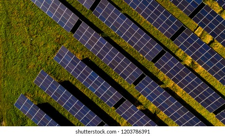 Aerial view Solar panels  (solar cell) in solar farm with sun lighting to create power energy  Concept of clean electric power and of sustainable resources