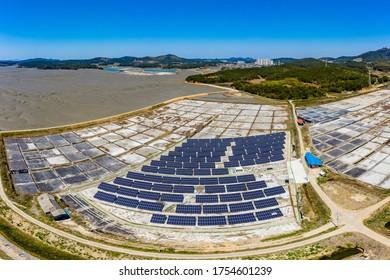 Aerial view of solar panels on the abandoned saltern near Seosan-si, South Korea - Shutterstock ID 1754601239