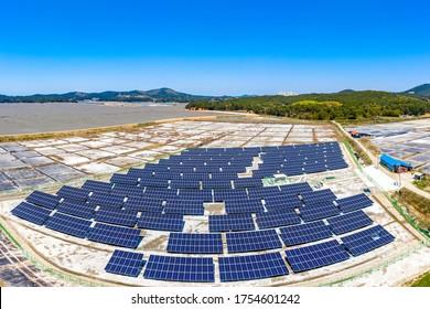 Aerial view of solar panels on the abandoned saltern near Seosan-si, South Korea - Shutterstock ID 1754601242