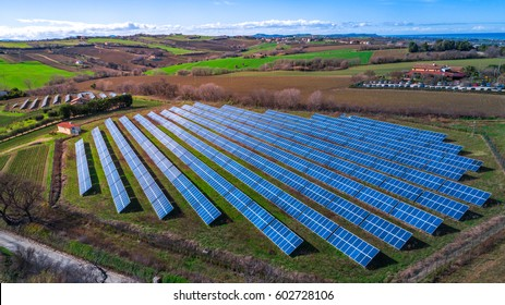 Aerial view of Solar panels Photovoltaic systems in italy, industrial landscape