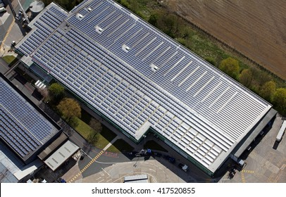 aerial view of solar panels pv cells on a factory roof in the UK